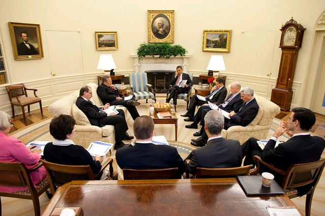 President Barrack Obama meets with senior advisors in the Oval Office