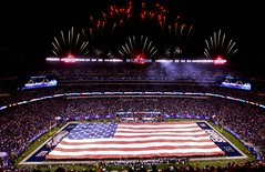 Marines, Sailors, Coast Guardsmen, Airmen and Soldiers unfurl American Flag at New York Giants military appreciation game Nov. 20