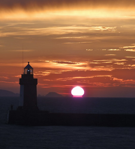 light sea sky orange sun lighthouse colour water sunrise dawn colourful guernsey sunup shimmering daybreak firstlight thechannel stpeterport castlelight letac