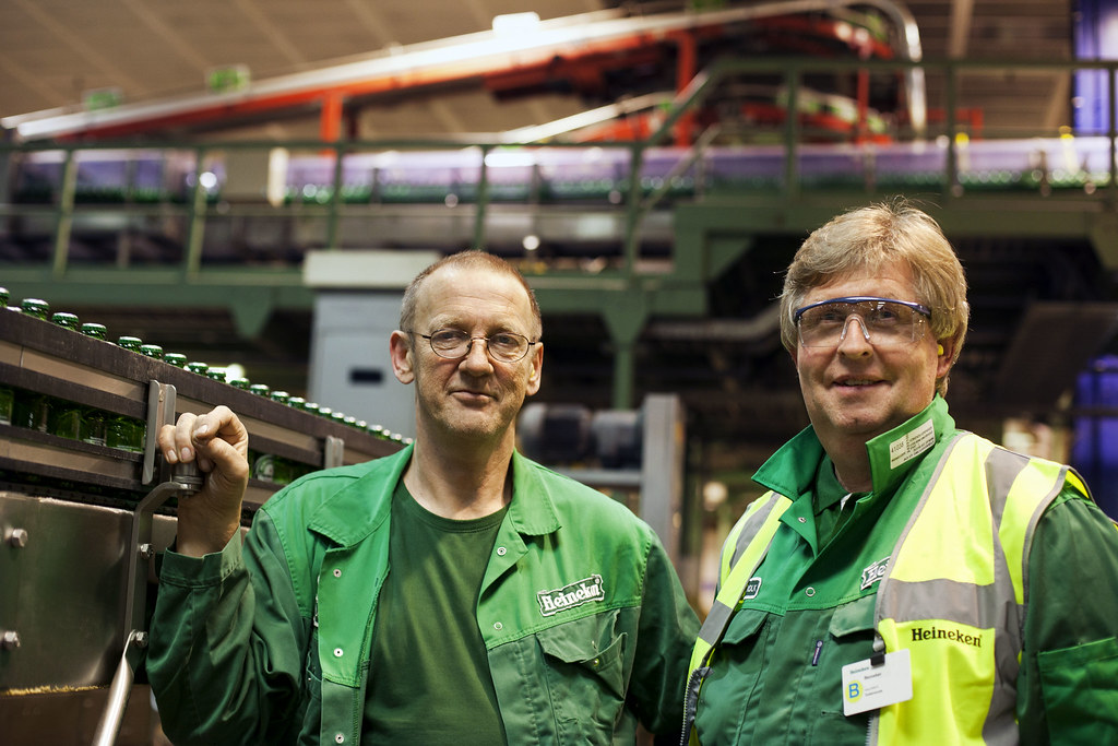 Heineken employees stand proudly inside a production facility in Zoeterwoude, Netherlands.