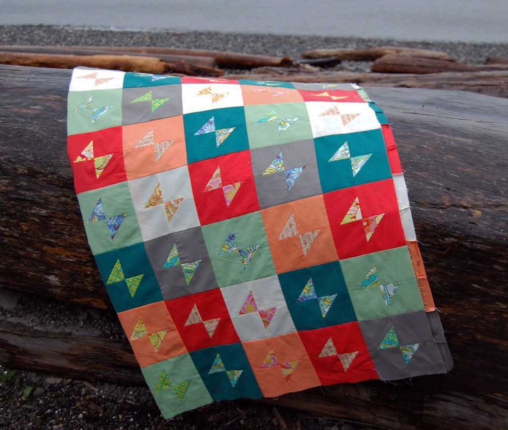 """Rainbow Pop"" bow-tie quilt top"