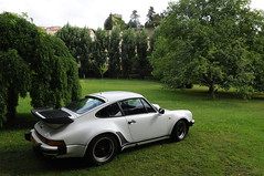 porsche 959(0.0), convertible(0.0), automobile(1.0), automotive exterior(1.0), wheel(1.0), vehicle(1.0), performance car(1.0), automotive design(1.0), porsche 911 classic(1.0), porsche 930(1.0), land vehicle(1.0), supercar(1.0), sports car(1.0),