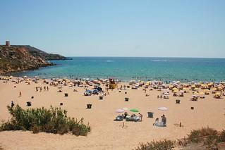 Imagen de Golden Beach. sea beach malta umbrellas