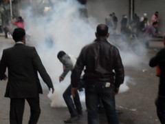 Man Tries to Throw Back tear Gas Canister - Talaat Harb
