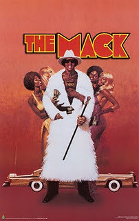 movie poster featuring a black man in a fur coat flanked by women called The Mack