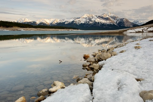 snow reflection ice spring rocks alberta canadianrockies abrahamlake