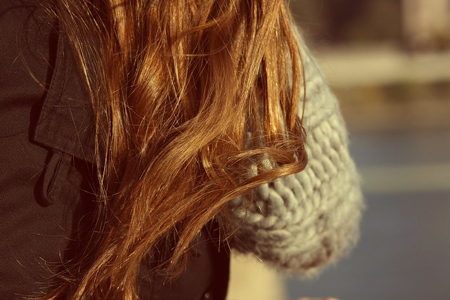 scarf and brown hair.