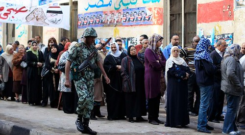 Soldiers patrols the lines of voters in Egypt who are participating in the first post-uprising elections on November 28, 2011. Egypt has been rocked by unrest over the last year. by Pan-African News Wire File Photos