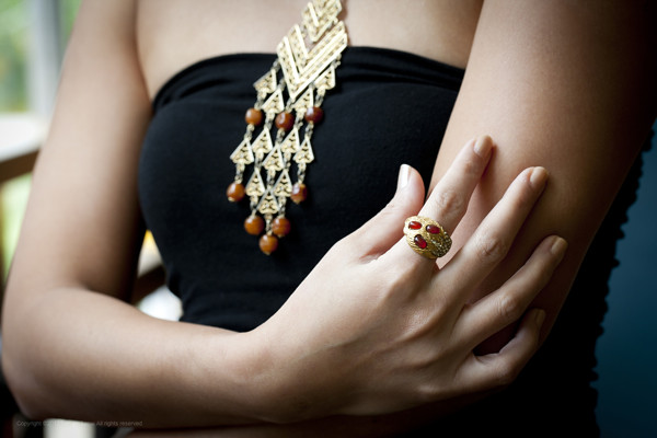 Background: 1960s gold-toned medieval necklace with brown beads; Foreground: Gold-toned ring with brown beads and crystals
