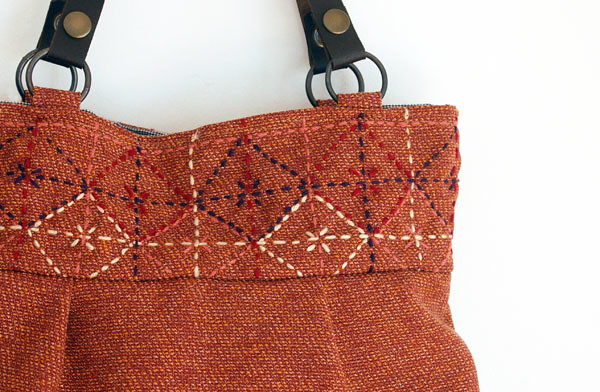 Tiles on camel tweed bag