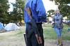 Diana talking to man with loaded AKM (Romanian AK-47)