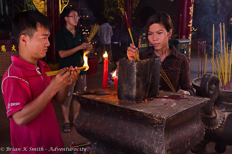 Quan Am Pagoda Worshipers light incense.