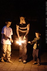 mother and sons lighting sparklers