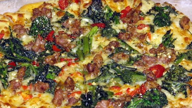 Broccoli rabe and sausage pizza - closeup