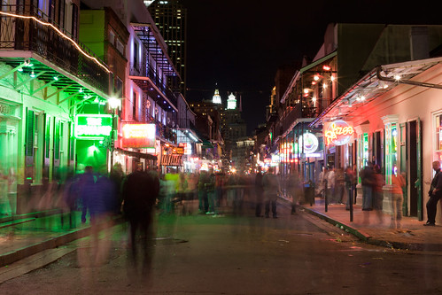 Bourbon Street in New Orleans at night, shadow figure walking. Bourbon Street, New Orleans, Louisiana