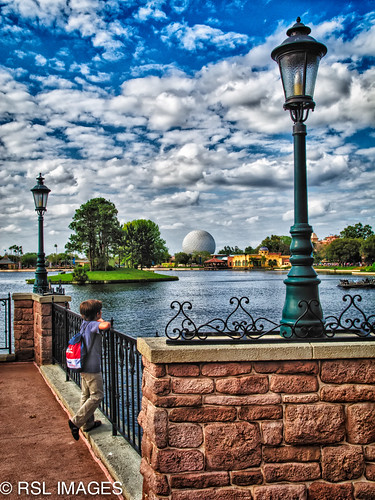 bridge boy water clouds epcot florida disney future backpack imagination lamps railing tomorrow daydream hdr 2012 spaceshipearth nikonflickraward