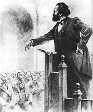 A depiction of Karl Marx addressing the founding meeting of the International Working Men's Association, First International, in London during 1864. Marx wrote extensively on the impact of the capitalist system on workers and farmers. by Pan-African News Wire File Photos