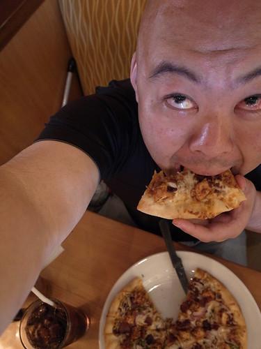 Me eating Piza at CPK