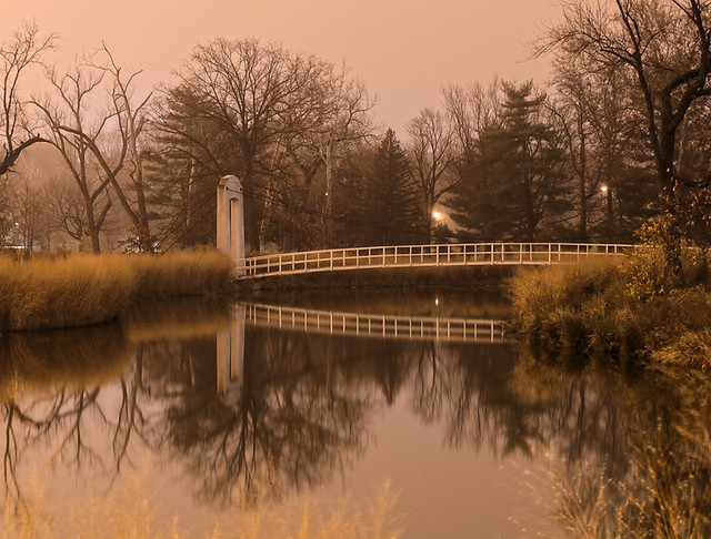 Forest Park, in Saint Louis, Missouri, USA - suspension bridge at night in fog
