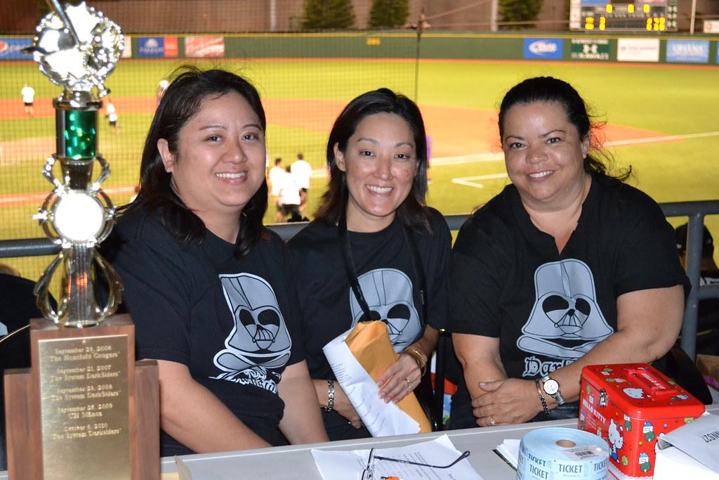 <p>Tournament coordinator Reyna Iwamoto with volunteers Joyce Chun and Christine Neves at the the UH AUW Softball Tourment at Les Murakami Stadium on Sept. 30, 2011</p>