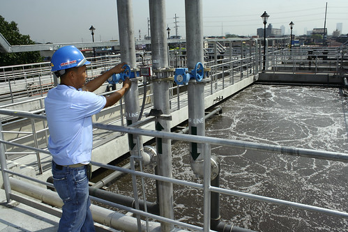 Worker at waster water treatment facility