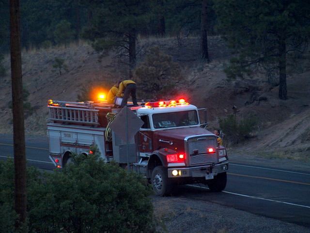 "One of several emergency vehicles stationed along the edge of Los Alamos National Laboratory near the Las Conchas Fire, below a ridge that was on fire (see  photo titled ""Flames above Los Alamos."")  Photo by Jeff Berger"