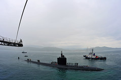 SEPANGAR, Malaysia (Oct. 13, 2011) Los Angeles-class submarine USS Columbia (SSN 771) prepares to come alongside submarine tender USS Emory S. Land (AS 39) on the U.S. Navy's 236th birthday. (U.S. Navy photo by Mass Communication Specialist 2nd Class Chris Williamson)