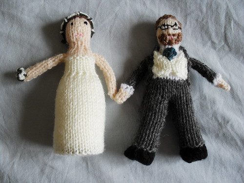 Salvaged cake with knitted toppers The knitted wedding cake topper