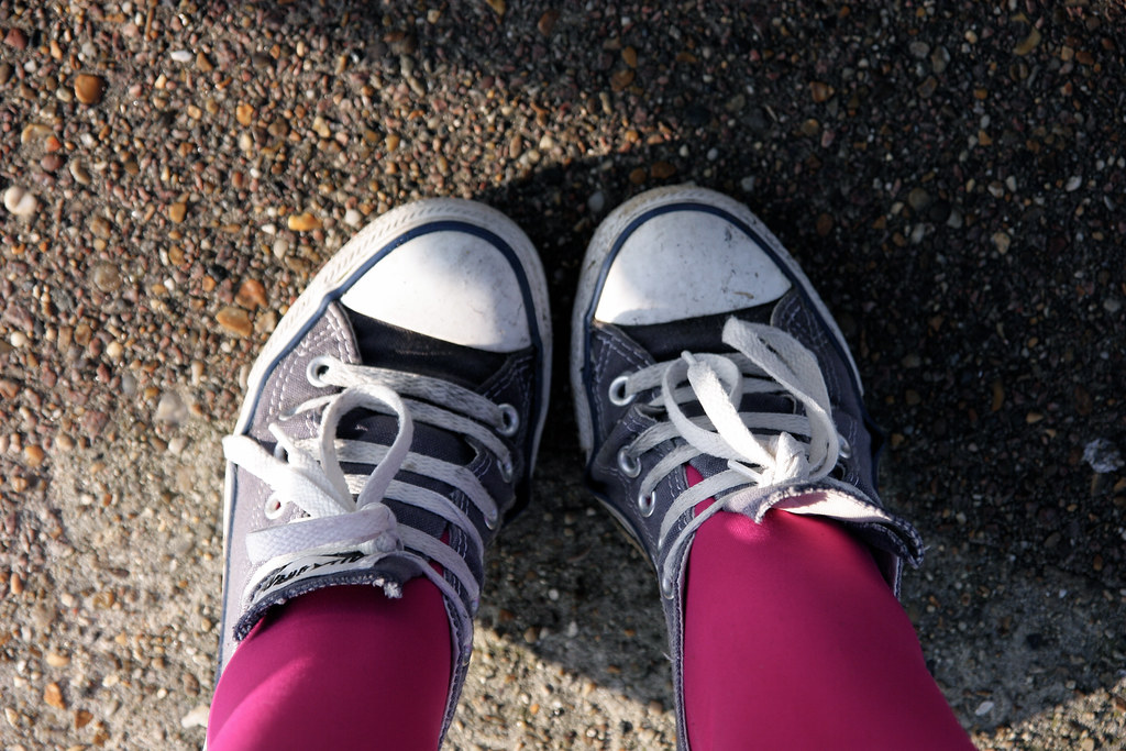 Blue Converse and pink tights