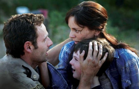Scene from the Walking Dead. Lori and Rick embracing with their child between them