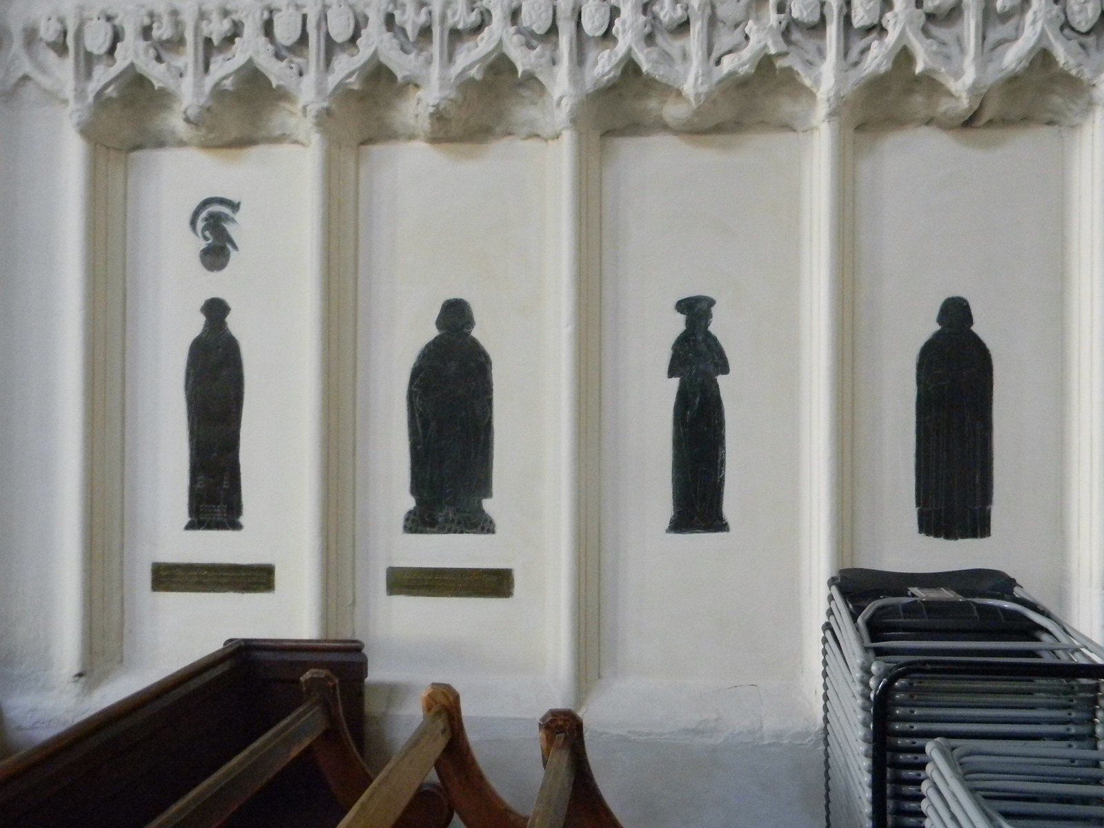 Displaced brasses - assorted geysers Vandalised during the dissolution and placed in the wall. It looks like they've had a couple of visits from Darth Vader as well (images 2 and 4). St Mary's church, Saffron Walden. Great Chesterford to Newport