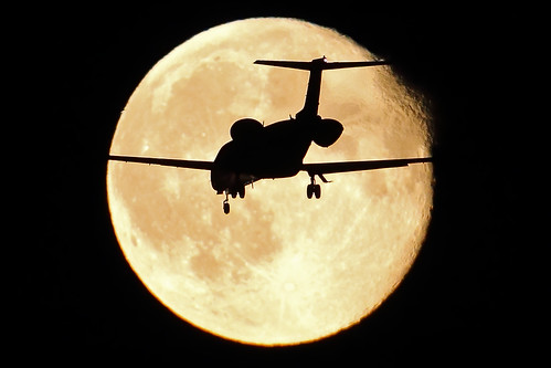unknown airplane crossing the moon at EHAM Schiphol