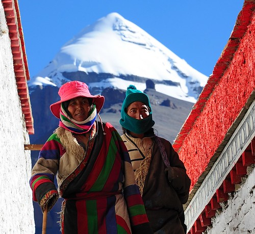 Pilgrims circumambulate the Choku monastery, Mount Kailash in the background. Tibet by reurinkjan