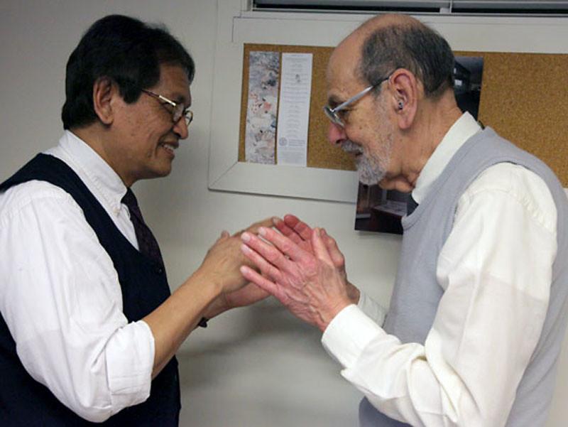 CRP Professor Iwan Azis speaks with Professor Emeritus Sid Saltzman.