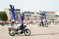 racing(0.0), freestyle motocross(0.0), bicycle motocross(0.0), cycle sport(0.0), bmx racing(0.0), bicycle(0.0), vehicle(1.0), race(1.0), motorcycle(1.0), motorcycling(1.0), stunt performer(1.0), stunt(1.0),