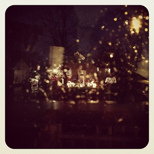 Christmas house through the rainy window