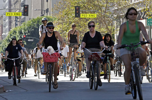 Bicyclists cruise down Spring Street in participation of CicLAvia in downtown Los Angeles, 2010