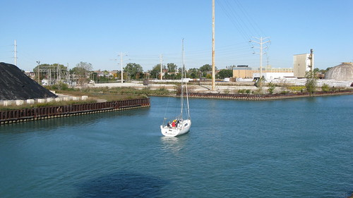 Southbund sailboat on the Calumet River.  Chicago Illinois USA. Saturday, October 15th, 2011. by Eddie from Chicago