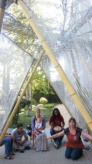 Families enjoy storytime in the sukkah