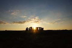 The autumn sun, setting behind Stonehenge