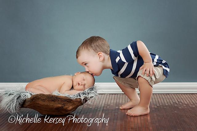 brothers portrait newborn 2yr old; sweet kisses