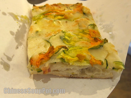 [photo-slice of zucchini flower pizza]