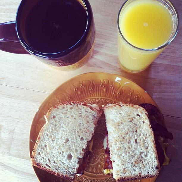 Breakfast: coffee, OJ, egg sandwich with maple bacon, Helluva Good ...