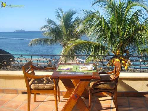 waterfront seating - family friendly hotel - roatan, honduras