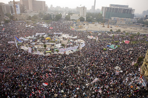 Image of Tahrir Square crowded with people and banners.