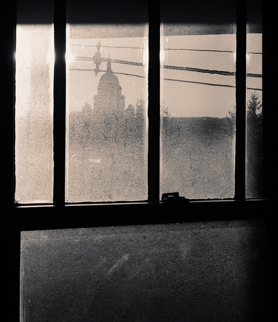 dirty window, power lines, state house