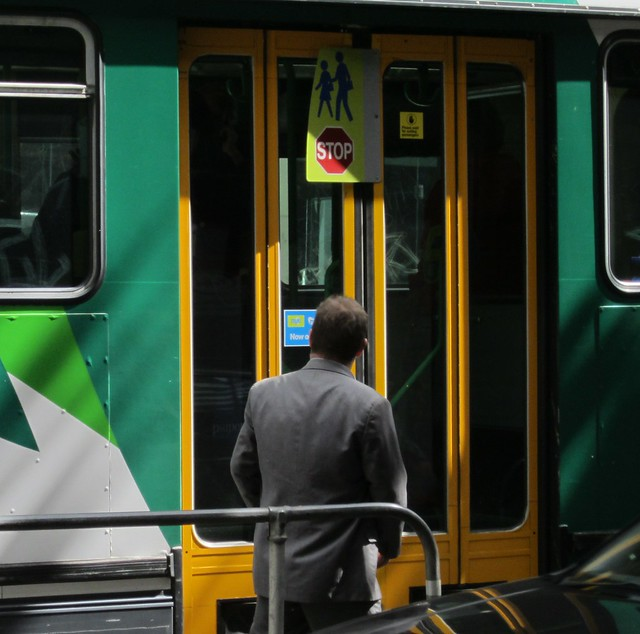 """""""Please wait for exiting passengers"""" - Yarra Trams sticker"""