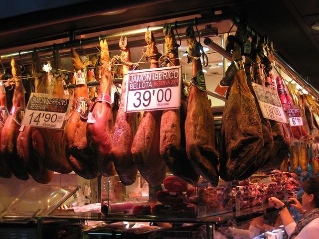 jamón serrano / ibérico (spanish ham) hanging @ boquería market, barcelona
