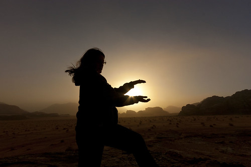 shadow red sky orange sun mountain holiday hot color colour dusty nature silhouette rock sunrise dawn lawrence sand desert outdoor walk sandy wadirum middleeast dry hike adventure jordan arabia remote dust shape wadi arid jor bedouin ramm landbased al'aqabah