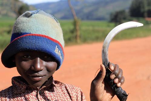 africa boy weed child rwanda sickle weeding childlabor adamcohn wwwadamcohncom